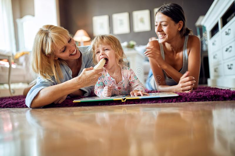 Mother gives banana to her girl royalty free stock photos