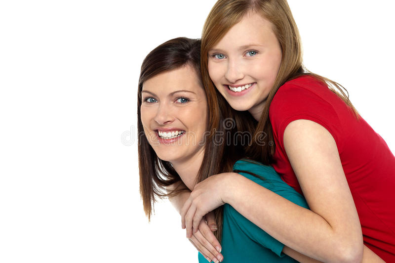 Download Mother Giving Daughter Ride On Back Stock Photo - Image: 28004382