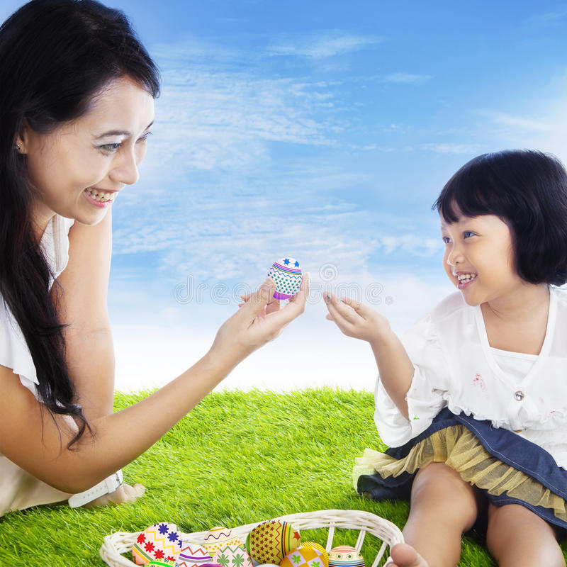 Mother Giving Easter Egg Stock Image
