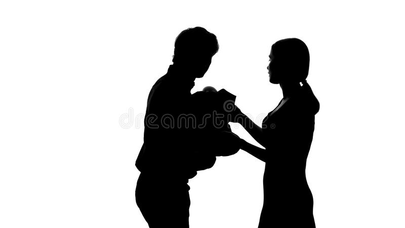 Mother giving newborn baby to happy father, planned child born in loving family royalty free illustration