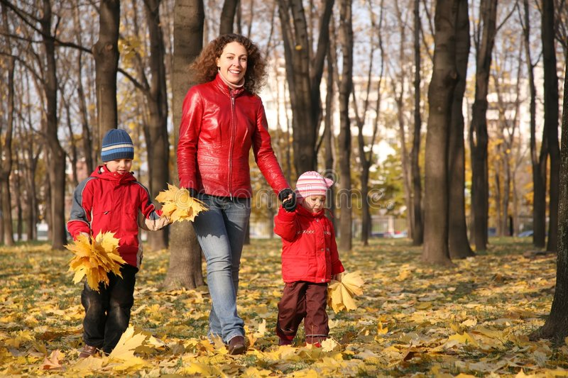 Mother goes for walk with children royalty free stock image