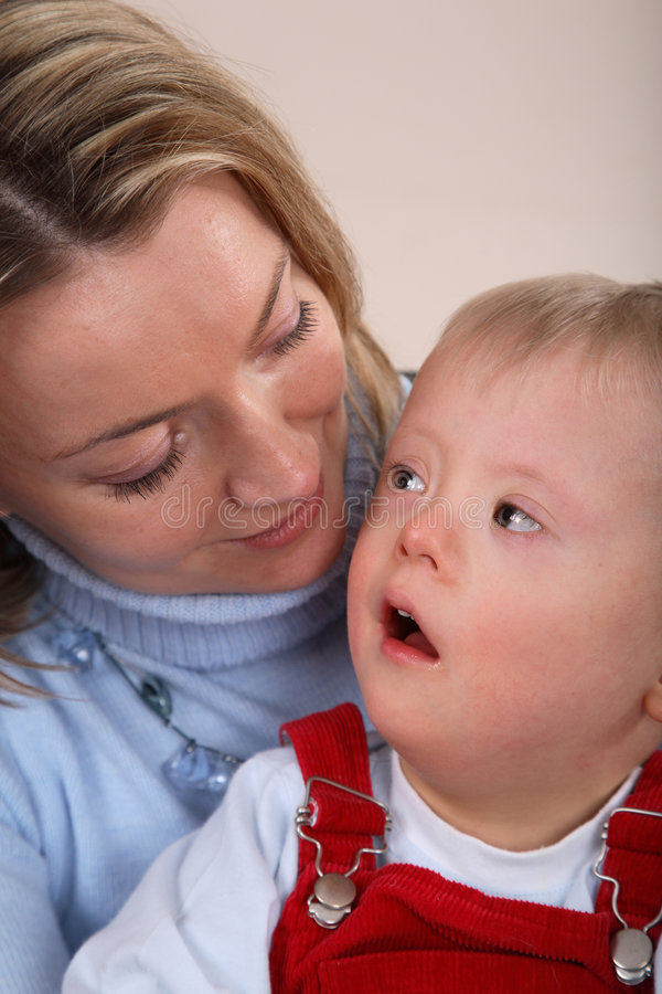 Mother with handicapped child royalty free stock photography