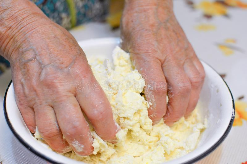 Mother hands cooking pie. Best hands - mother hands royalty free stock image