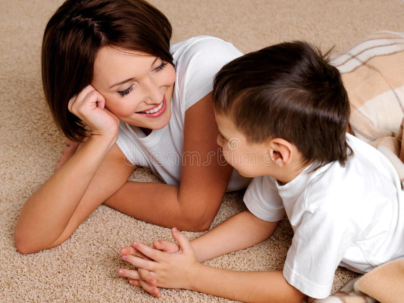 Mother has a good time in conversations with son stock image