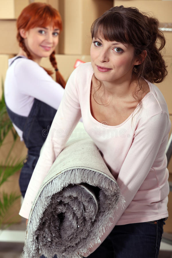 Mother helping her daughter move royalty free stock photo