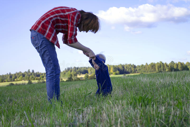 Mother Helping Her Little Daughter to Stand Up stock photos