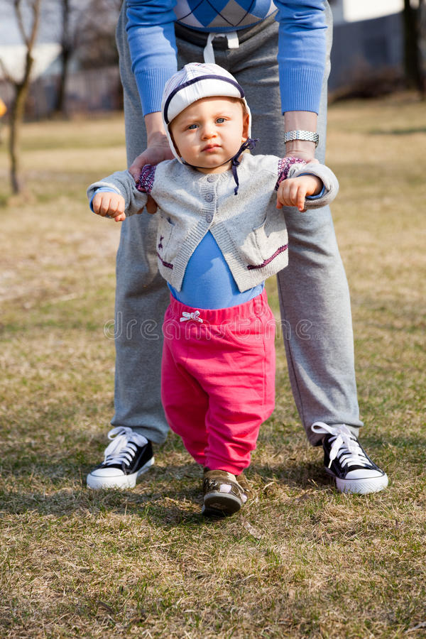 Download Mother Helping Son Learn To Walk Stock Image - Image: 22371993