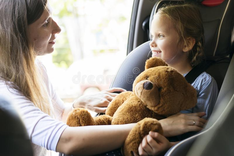 Mother helping to put on the seat belt stock photos