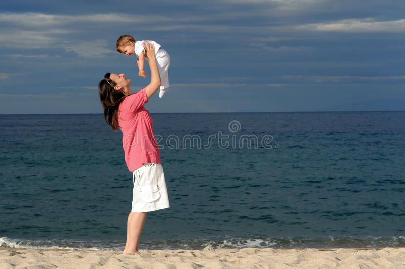 Download Mother With Her Baby At Beach Stock Photo - Image: 18991516