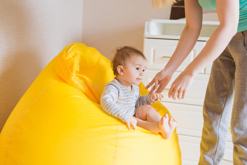 Mother and her baby child. Mom playing with laughing kid. Family at home royalty free stock image