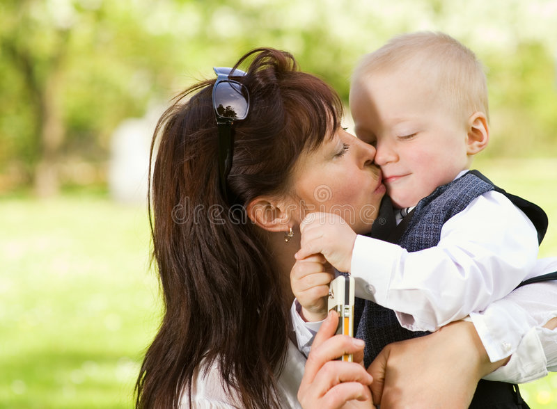 Mother with her child outdoors stock photos