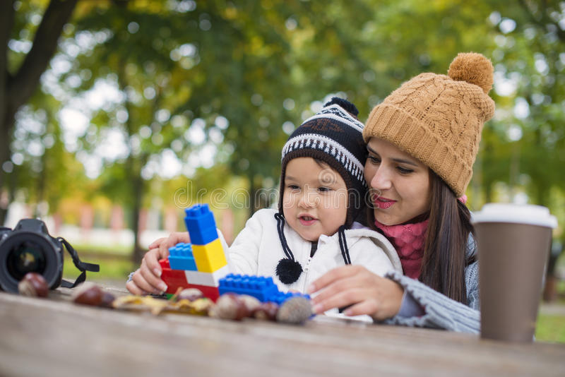 Mother with her child play in park playing with blocks stock photo
