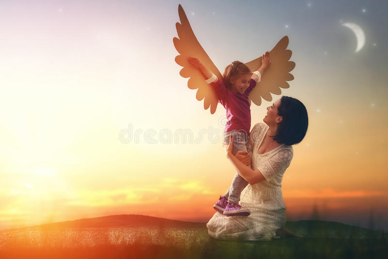 Mother and her child playing stock image