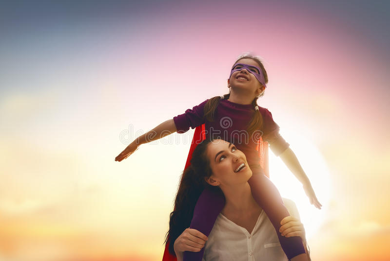 Mother and her child playing royalty free stock image