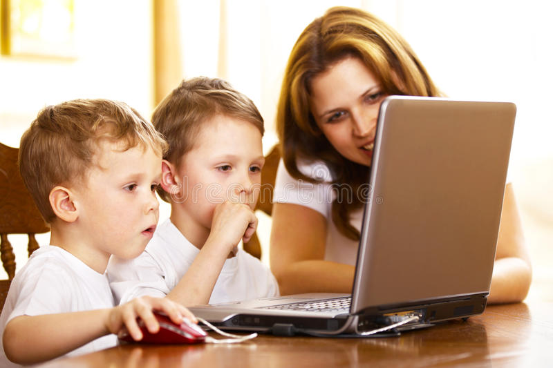 Download Mother With Her Children Using Laptop Stock Image - Image: 13865787
