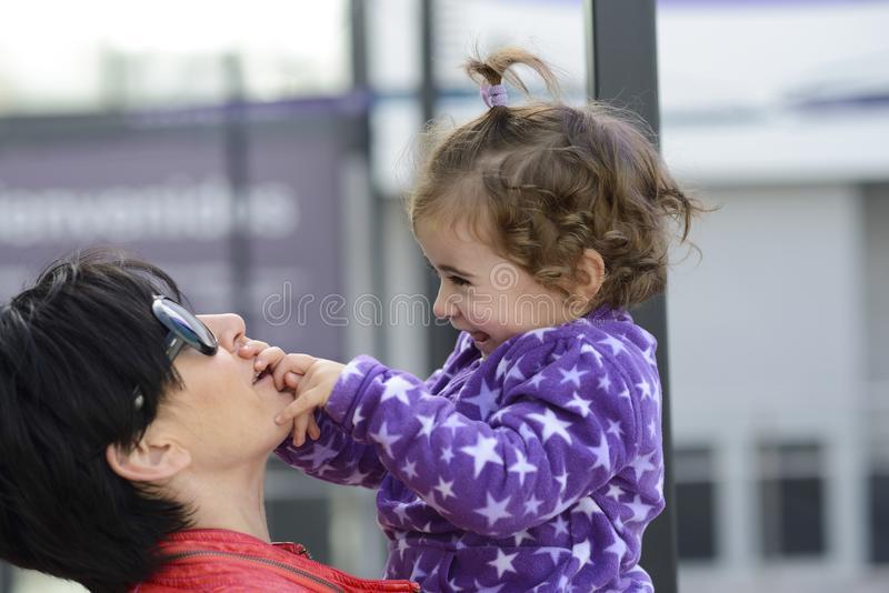 Mother and her cute little daughter having fun royalty free stock photo