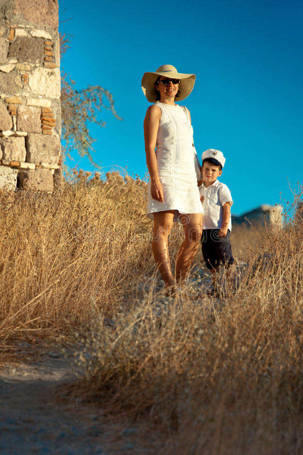Mother and her cute little son walking outdoors royalty free stock images