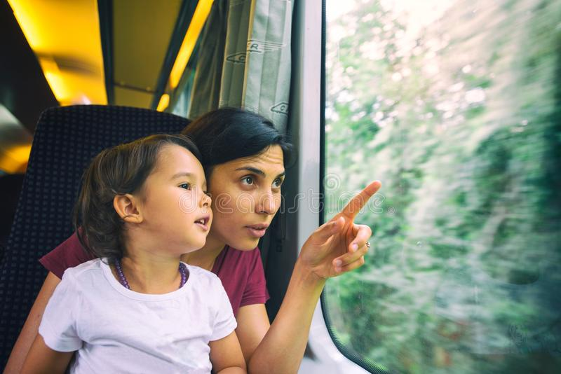 Mother and her daughter enjoing the train trip royalty free stock images
