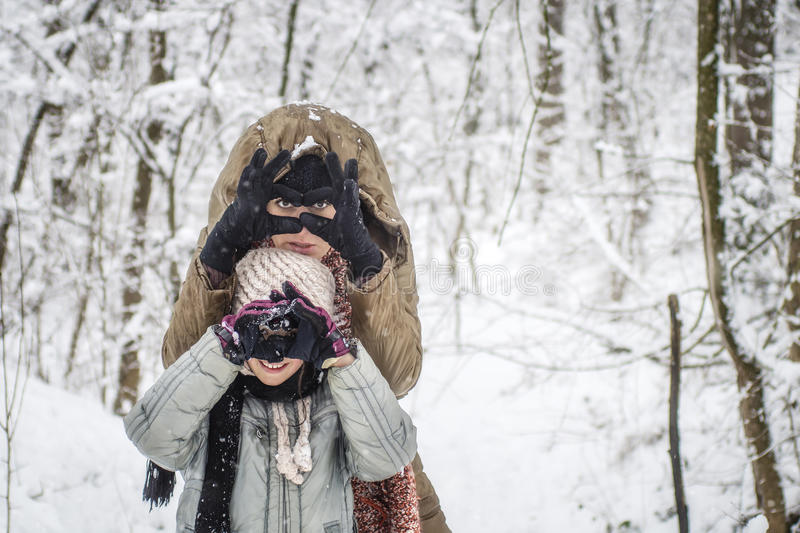 Mother and her daughter enjoying winter day outdoors royalty free stock image