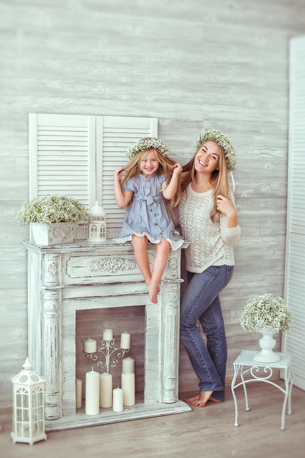 A mother and her daughter are laughing stock photos