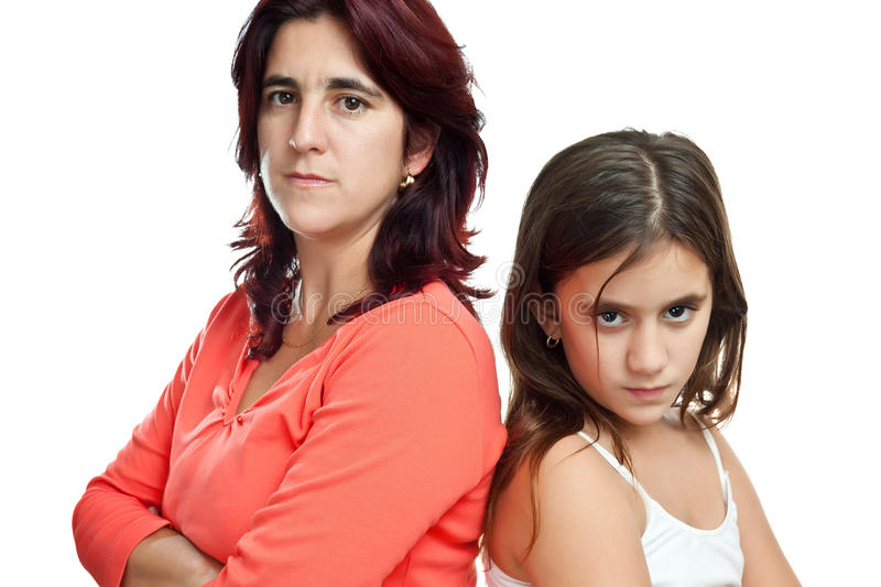 Mother and her daughter mad at each other. Young latin mother and her daughter mad at each other isolated on white stock image