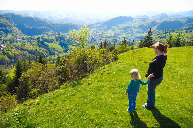 Mother with her daughter mountain landscape stock photos