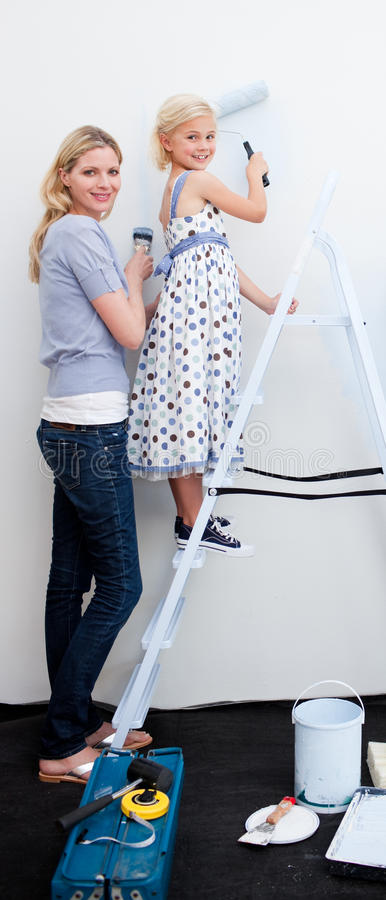 Download Mother And Her Daughter Painting Together Stock Photo - Image of apartment, laughing: 12054290