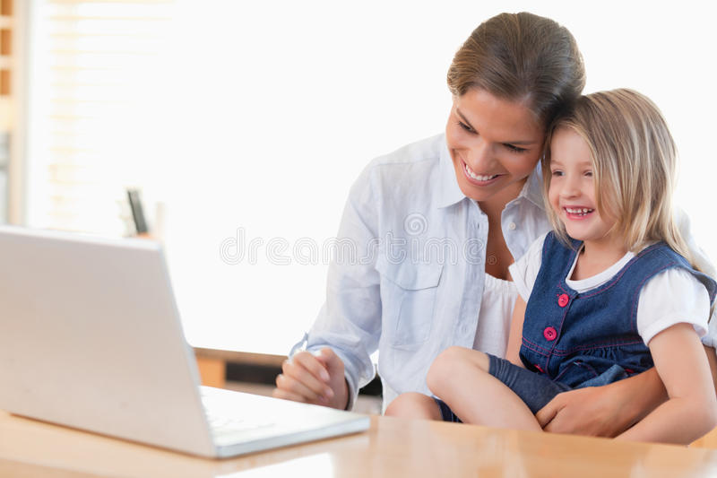 Download Mother And Her Daughter Using A Laptop Stock Image - Image: 22660565