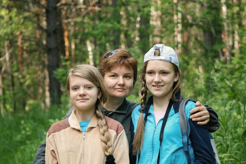 Mother and her daughters teenagers in park royalty free stock photography