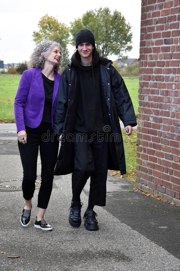 Best friends, mother and teenage son walking hand in hand. Mother and her grown up teenage son are best friends, walking together hand in hand and having fun stock photos