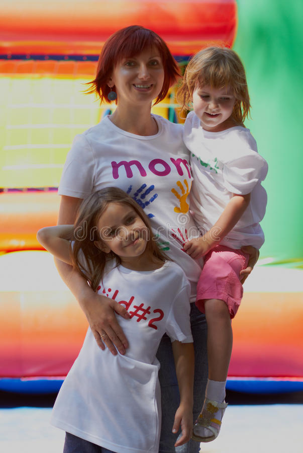 Mother with her kids outdoors stock images