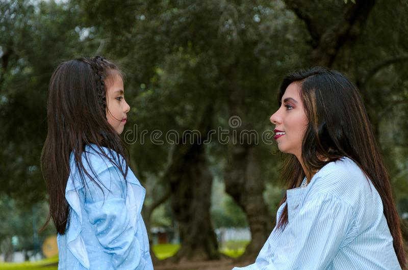 Mother and her little daughter looking at each other on a winter afternoon royalty free stock photo