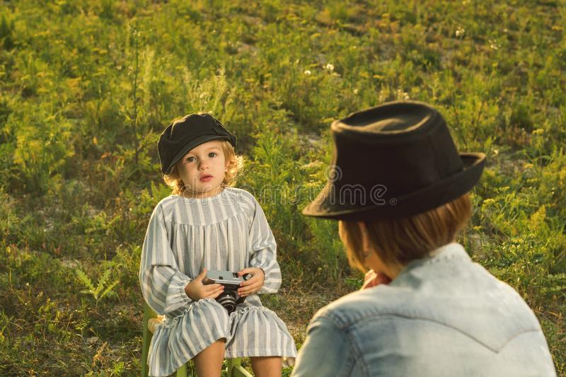 Mother and her little daughter playing in the field stock images