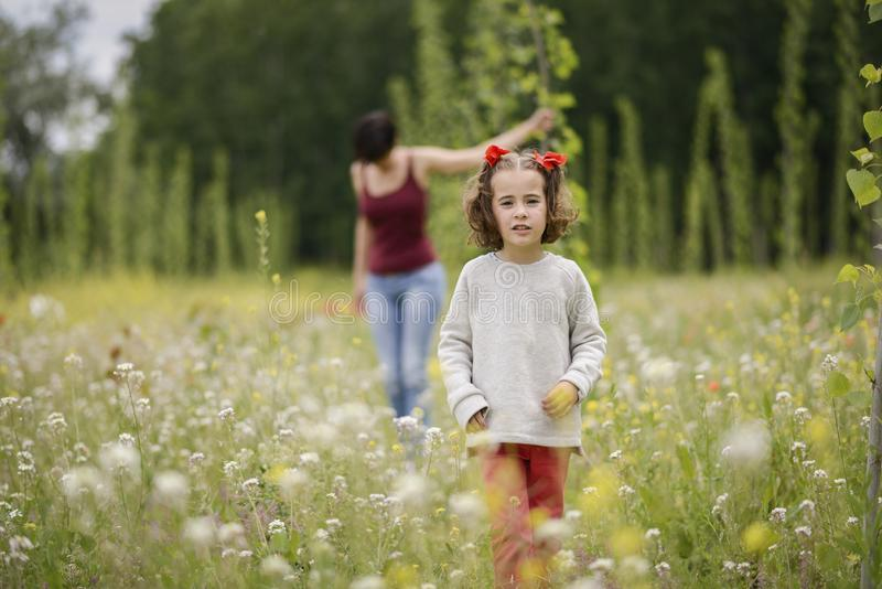 Mother with her little daughter in poppy field stock photography