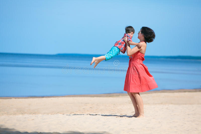 Mother And Her Little Son Playing On The Beach Royalty Free Stock Images