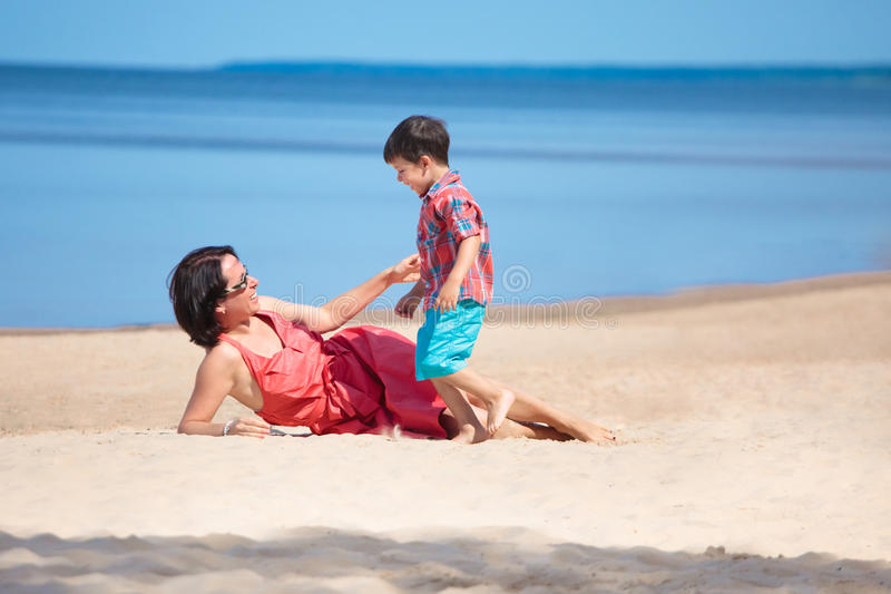 Download Mother And Her Little Son Playing On The Beach Stock Photo - Image: 23249540