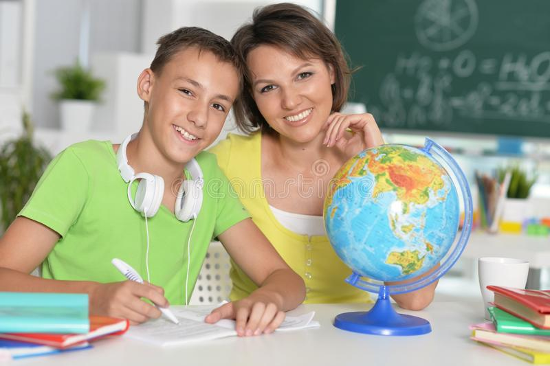 Portrait of mother with her son doing homework royalty free stock photos