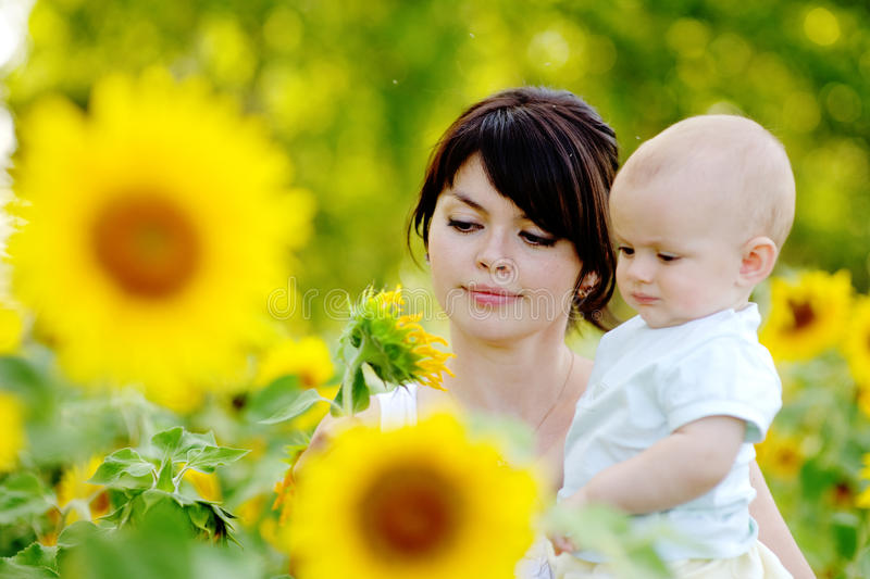 Mother and her son looking at sunflower royalty free stock photo