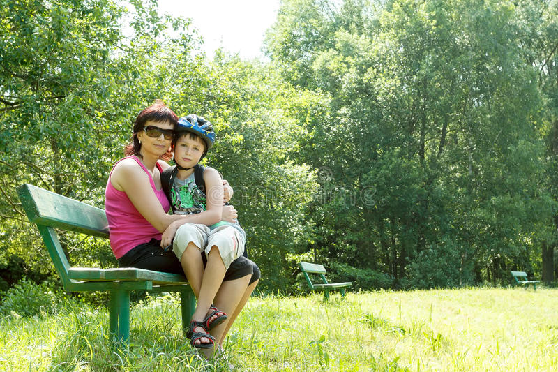 Mother and her son outdoor stock photos