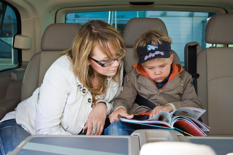 Download Mother And Her Son Are Reading A Book Stock Photo - Image: 5706198