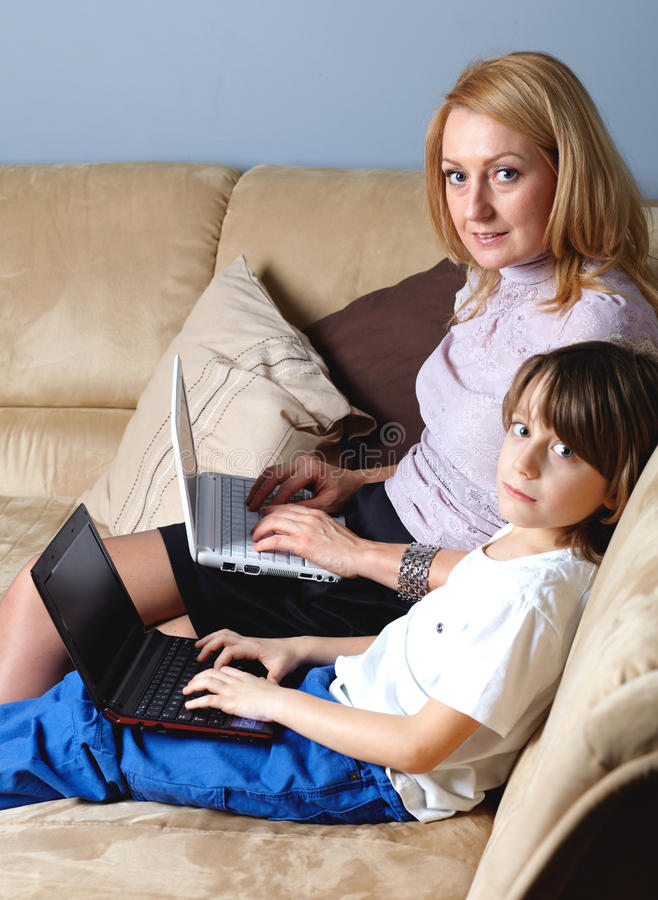 Mother with her son work on two netbook computers