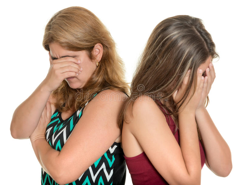 Mother and her teenage daughter both crying. Family problems, Teenager conflict - Mother and her teenage daughter both crying - Isolated on white royalty free stock photos