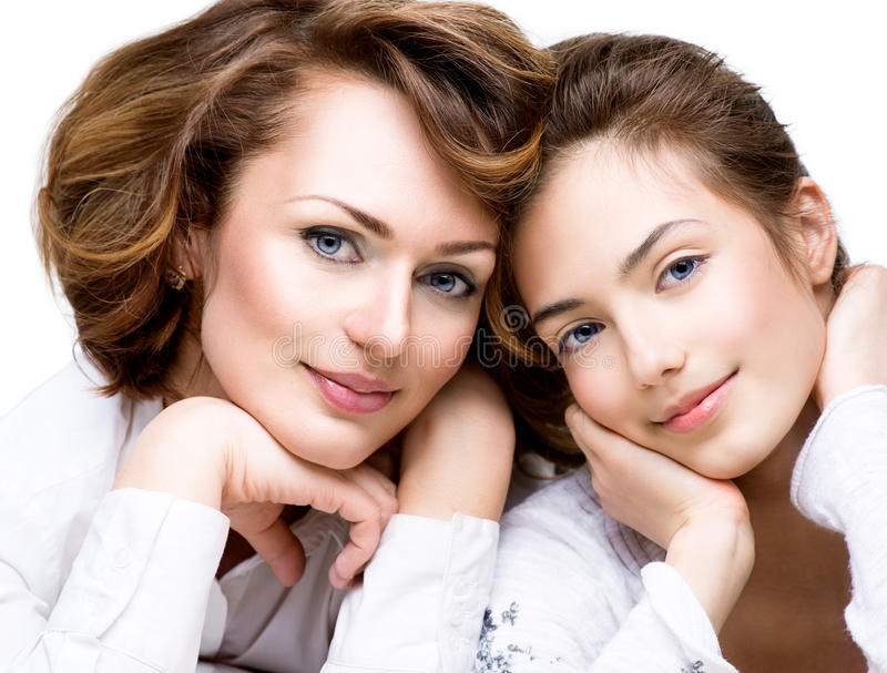 Mother and her Teenage Daughter. Close-up Portrait of Mother and her Teenage Daughter royalty free stock image