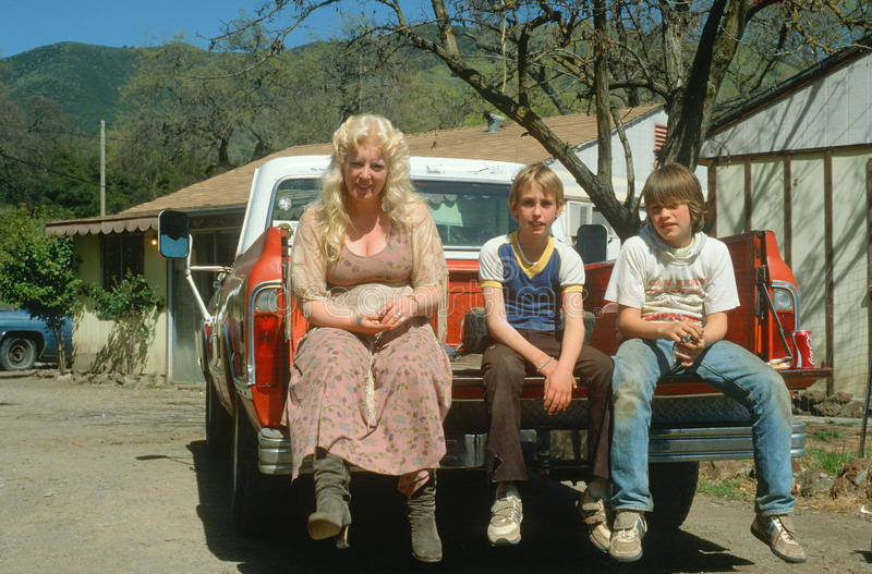 A mother and her teenage sons stock photos