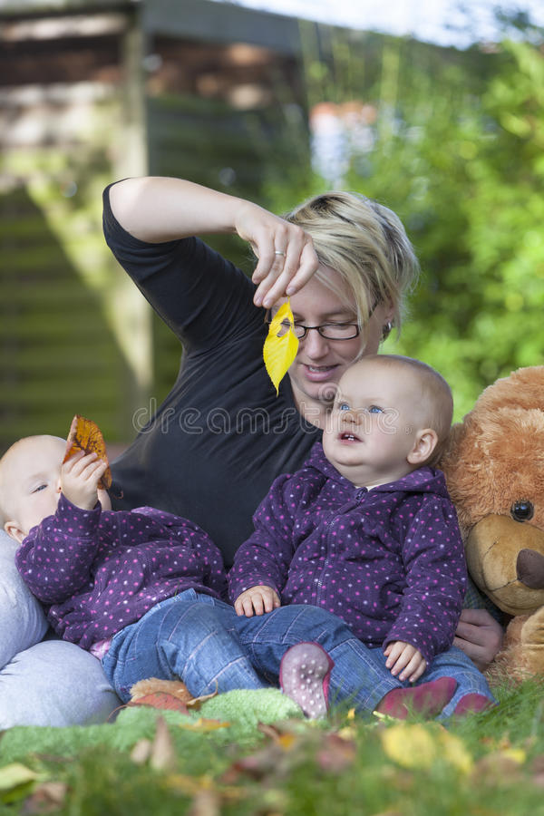 Mother and her twin daughters royalty free stock photos