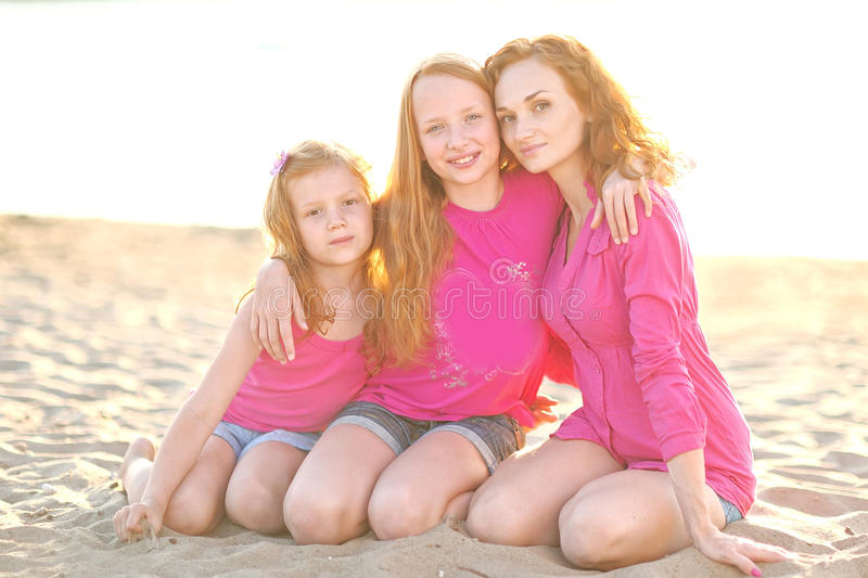 Mother and her two daughters royalty free stock photos