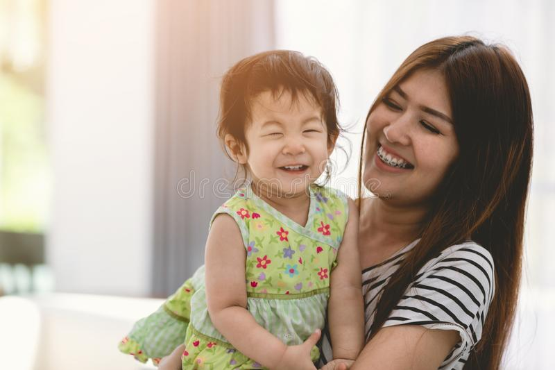 Mother and her baby girl lifestyle image at home. Portrait of asian mother and her baby girl lifestyle image at home royalty free stock image