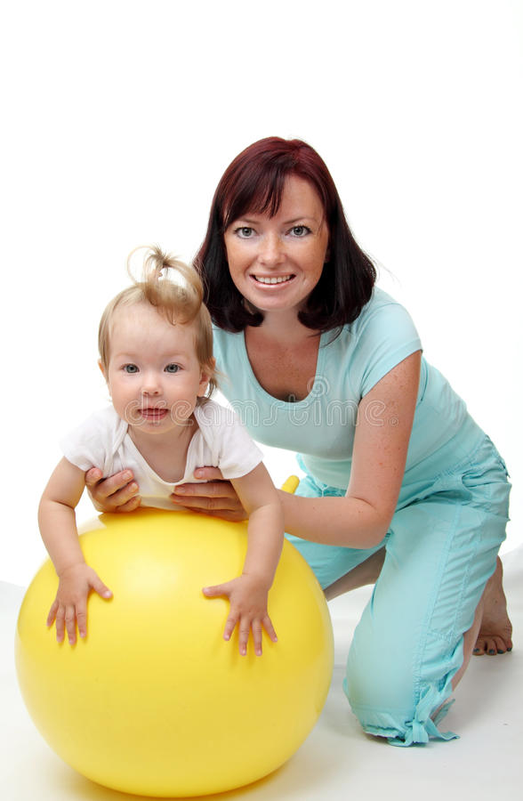 Download Mother Hold Daughter On Fitness Ball Stock Photo - Image of gray, childhood: 10241992