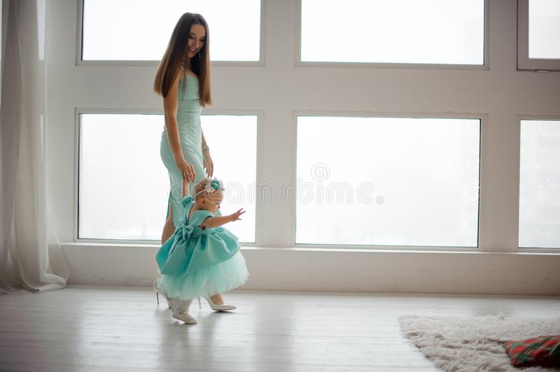 Mother hold her daughter hand and walking in the room stock images
