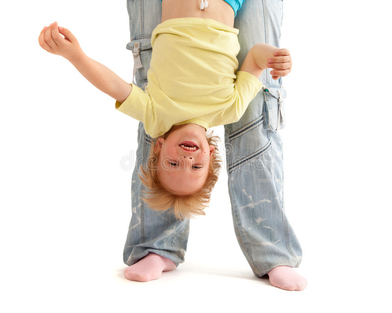 Mother hold her smiling son upside down stock images